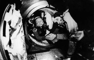 Commander+of+the+Soviet+crew+of+Soyuz,+Alexei+Leonov+(L)+and+commander+of+the+American+crew+of+Apollo,+Thomas+Stafford+(R),+shake+hands+17+July+1975+in+the+space,+somewhere+over+Western+Germany